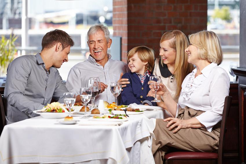 Happy family with child smiling together in a restaurant uroczystości biały dom